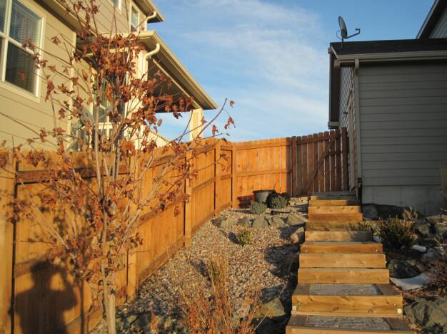 Cedar Fence Shared with Neighbor in Colorado Springs
