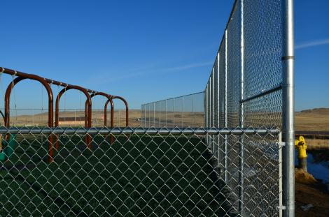 A Colorado Springs play yard 10 Foot High Chain Link Fence in Colorado